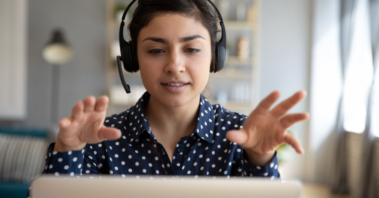 woman with headset at laptop