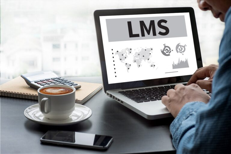 man at laptop with letters LMS onscreen
