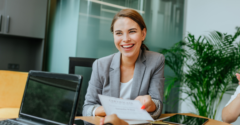 smiling businessperson with certificate